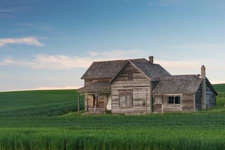 decrepit: Abandoned house and wheat fields at dusk, Colton, Washington
