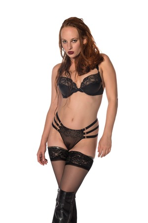 redhead lingerie: Pretty young redhead in black lingerie on white