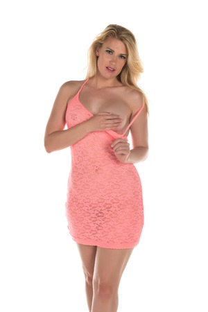Beautiful tall blonde in a coral pink dress