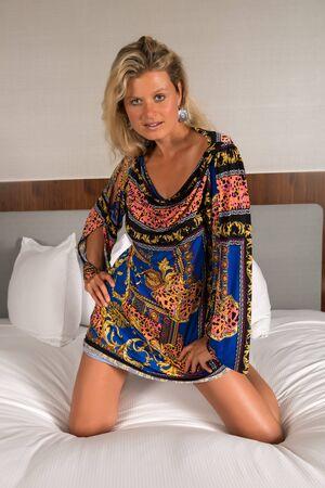 statuesque: Beautiful statuesque blonde woman in a colorful print dress
