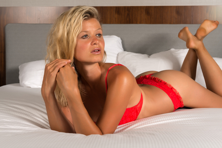statuesque: Beautiful statuesque blonde woman in bright red lingerie