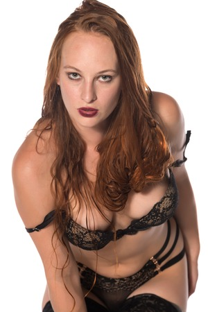 panty hose: Pretty young redhead in black lingerie on white