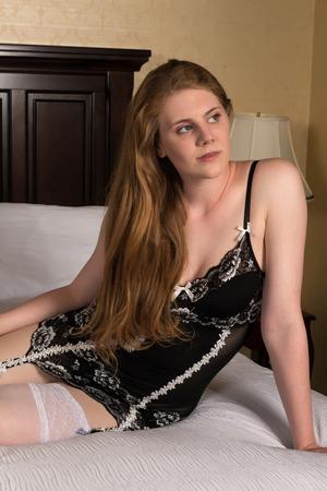 garters: Pretty statuesque blonde in black and white lingerie