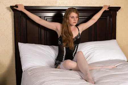girdle: Pretty statuesque blonde in black and white lingerie