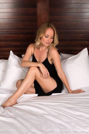 little black dress: Beautiful young blonde woman in a little black dress