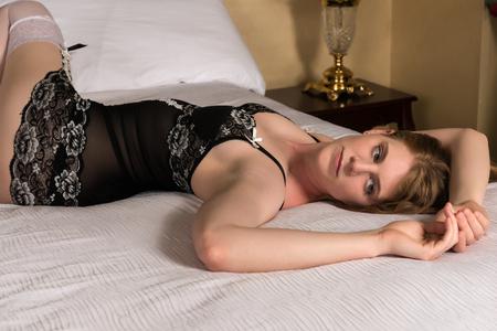statuesque: Pretty statuesque blonde in black and white lingerie