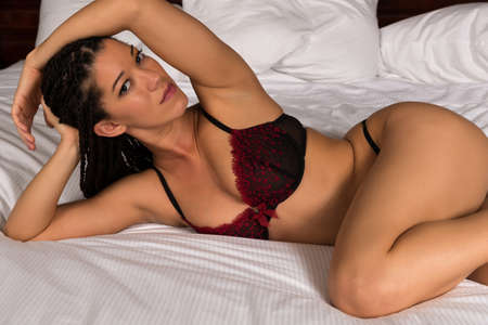 black lingerie: Beautiful multiracial woman in red and black lingerie