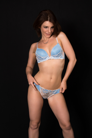 pale: Pretty petite brunette in pale blue lingerie