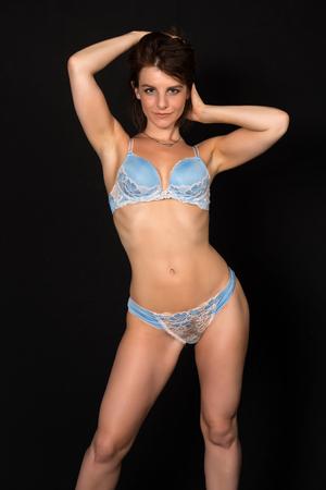 blue lingerie: Pretty petite brunette in pale blue lingerie