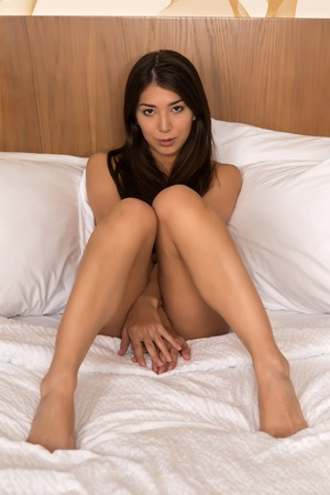 sexy topless women: Beautiful petite Eurasian woman topless in bed