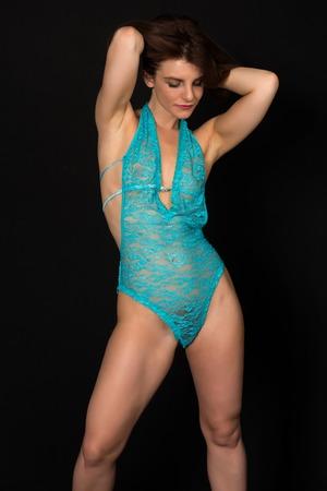 sheer: Pretty petite brunette in a sheer turquoise bodysuit