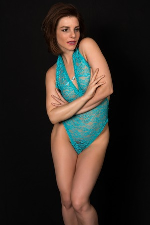 Pretty petite brunette in a sheer turquoise bodysuit
