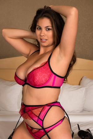 garters: Beautiful young Eurasian woman in revealing rose lingerie