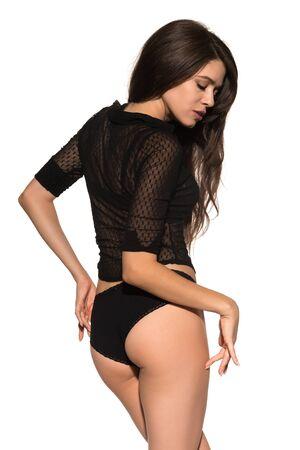 undergarment: Tall slender brunette dressed all in black
