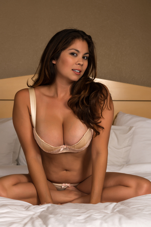 busty bra: Beautiful young Eurasian woman in yellow lingerie