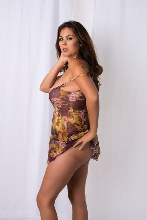 chemise: Beautiful young Eurasian woman in a flower print chemise