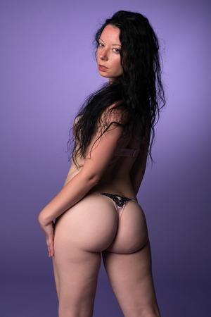 Petite pretty Italian brunette in pink lingerie Stock Photo