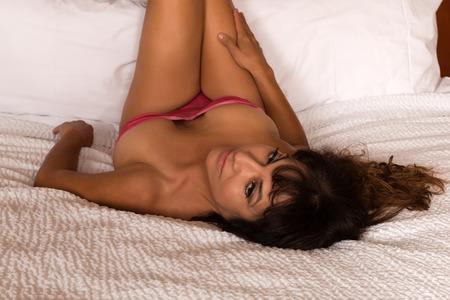 Pretty mature brunette in a rose bodysuit Stock Photo