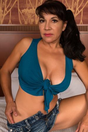 bluejeans: Pretty mature brunette in a cutoff top and denim shorts