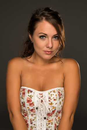 strapless: Portrait of a beautiful young brunette in a strapless top