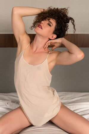 beige: Pretty petite brunette in a beige chemise Stock Photo