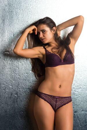 brassiere: Pretty Romanian brunette in purple lingerie