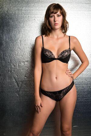 black lingerie: Beautiful tall brunette dressed in black lingerie
