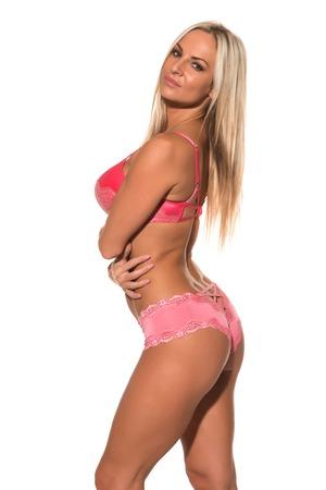 undergarment: Beautiful Czech blonde dressed in pink lingerie