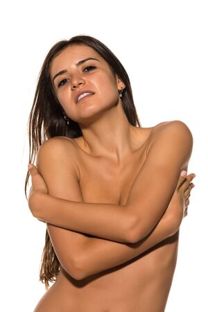 topless: Pretty Romanian brunette topless on white