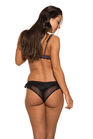 mauve: Pretty Romanian brunette in mauve and black lingerie Stock Photo