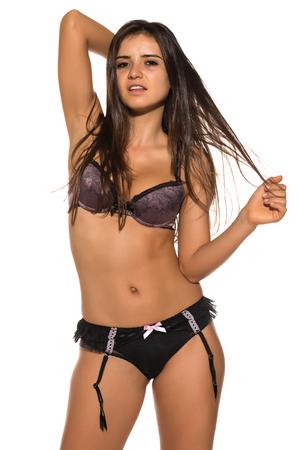brassiere: Pretty Romanian brunette in mauve and black lingerie Stock Photo