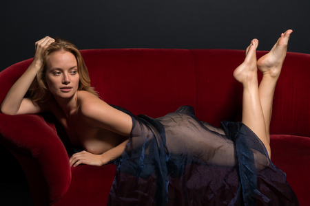 Beautiful young Hungarian blonde wrapped in blue tulle Imagens