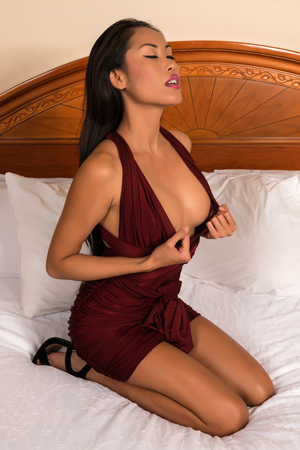 Beautiful slender Filipino woman in a purple dress