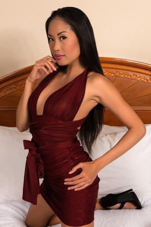 purple dress: Beautiful slender Filipino woman in a purple dress