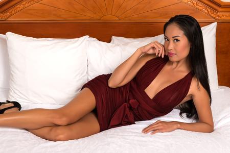 charming girl: Beautiful slender Filipino woman in a purple dress