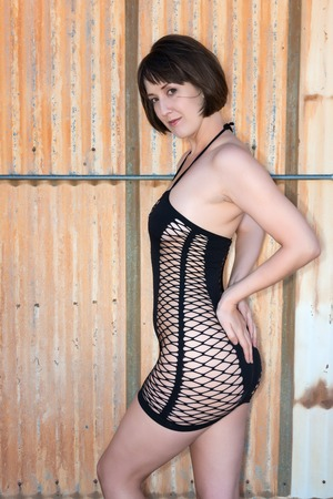 chemise: Tall shapely brunette in a black fishnet chemise