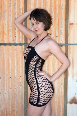 shapely: Tall shapely brunette in a black fishnet chemise