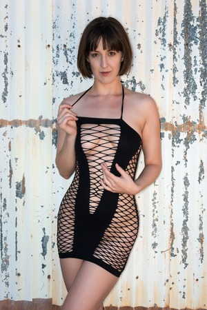 chemise: Tall shapely brunette in a black fishnet chemise