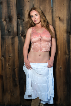 bodice: Beautiful tall redhead in a pink bodice and white skirt