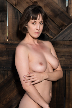 sexy nude women: Statuesque young brunette standing nude at a wooden door