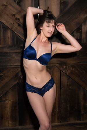 statuesque: Statuesque young brunette dressed in dark blue lingerie