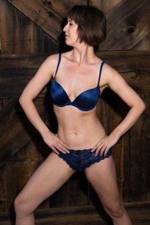 blue lingerie: Statuesque young brunette dressed in dark blue lingerie