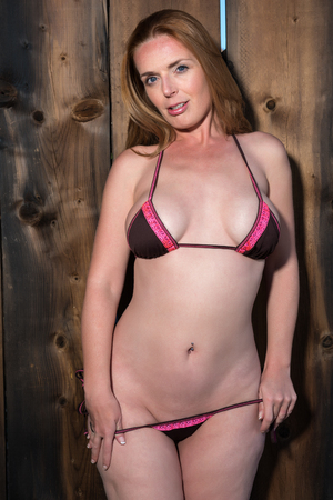 skimpy: Beautiful tall redhead in a pink and brown bikini