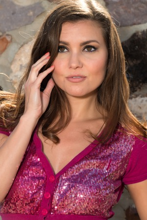 sequined: Pretty petite brunette in a purple sequined blouse