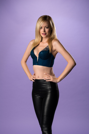 bodice: Pretty slender blonde woman in a teal bodice and black leggings