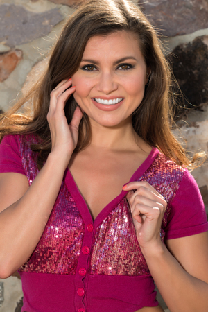 brick kiln: Pretty petite brunette in a purple sequined blouse