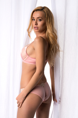 Beautiful slender Czech blonde in pink lingerie