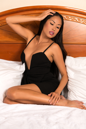 revealing: Beautiful slender Filipino woman in a revealing black dress