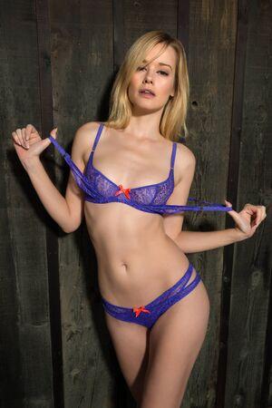 blue lingerie: Pretty slender blonde woman in blue lingerie