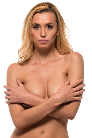 naked young women: Beautiful slender Czech blonde sitting nude on white Stock Photo